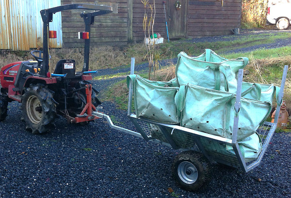 Mini Timber Trailer with compact tractor. Made in Britain